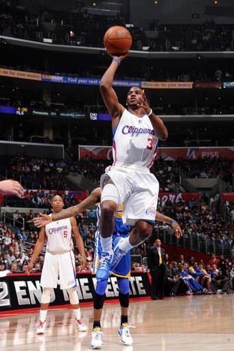 LOS ANGELES, CA - APRIL 14: Chris Paul #3 of the Los Angeles Clippers goes up for a shot against the Golden State Warriors at Staples Center on April 14, 2012 in Los Angeles, California. (Photo by Andrew D. Bernstein/NBAE via Getty Images)