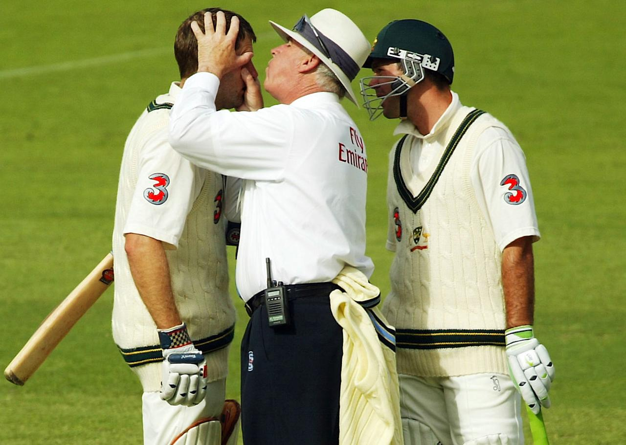 ADELAIDE, AUSTRALIA - DECEMBER 12:  Simon Katich of Australia receives attention to his eye from umpire Rudi Koertzen with Ricky Ponting of Australia looking on during the first day of the 2nd Test Match between Australia and India at the Adelaide Oval on December 12, 2003 in Adelaide, Australia. (Photo by Hamish Blair/Getty Images)