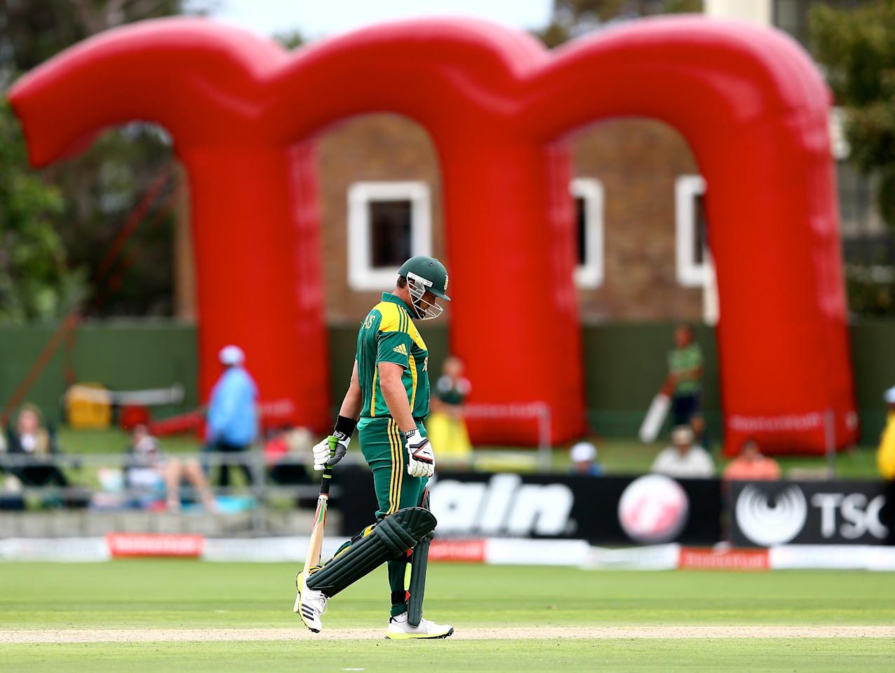 PORT ELIZABETH, SOUTH AFRICA - NOVEMBER 27: Jacques Kallis of South Africa leaves the pitch after being caught out by Saeed Ajmal of Pakistan during the 2nd One Day International match between South Africa and Pakistan at AXXESS St Georges on November 27, 2013 in Port Elizabeth, South Africa. (Photo by Richard Huggard/Gallo Images)