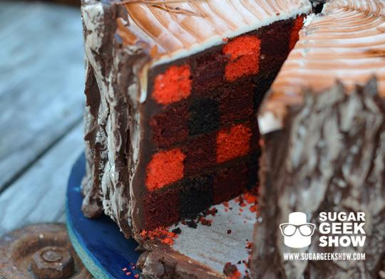 "<p>Marek is <a href=""https://sugargeekshow.com/news/this-lumberjack-tree-trunk-cake-looks-cozy-on-the-inside"">apparently obsessed</a> with all things lumber and was inspired to make the cake when she watched her husband chop down their Christmas tree. <a href=""https://sugargeekshow.com/news/this-lumberjack-tree-trunk-cake-looks-cozy-on-the-inside"">In her own words</a>: ""I love trees. I love beards. I love plaid."" <i>(Photo: <a href=""https://sugargeekshow.com/news/this-lumberjack-tree-trunk-cake-looks-cozy-on-the-inside"">Sugar Geek Show</a>)</i><br /></p>"