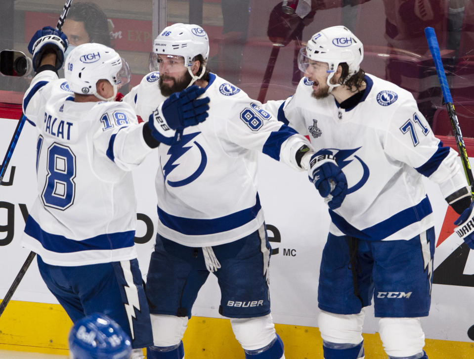 Tampa Bay Lightning right wing Nikita Kucherov (86) celebrates with Ondrej Palat (18) and Anthony Cirelli (71) after scoring against the Montreal Canadiens during the second period of Game 3 of the NHL hockey Stanley Cup Final, Friday, July 2, 2021, in Montreal. (Ryan Remiorz/The Canadian Press via AP)