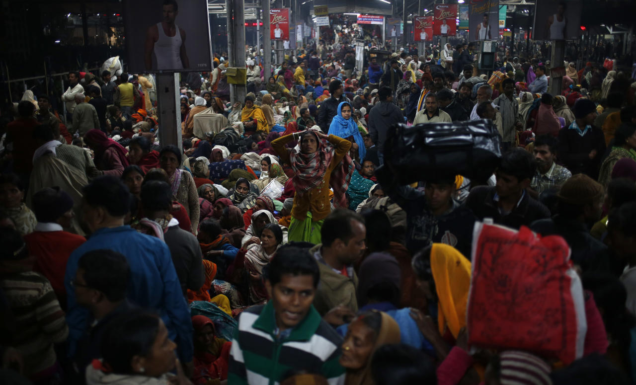 Thousands of people throng a platform waiting for trains to take them back home after visiting the Maha Kumbh festival in Allahabad, India, Sunday, Feb. 10, 2013. At least ten Hindu pilgrims attending the Kumbh Mela were killed and more then thirty were injured in a stampede on an overcrowded staircase of the Allahabad railway station, according to Railway Ministry sources. (AP Photo/Saurabh Das)