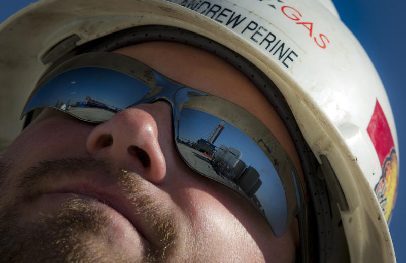 A Consol Energy Horizontal Gas Drilling Rig exploring the Marcellus Shale outside the town of Waynesburg, PA is reflected on worker's sunglasses on April 13, 2012. (MLADEN ANTONOV via Getty Images)
