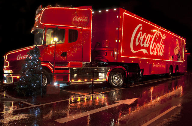 A Coca Cola lorry comes into town to light up a local supermarket car park in December 2012.