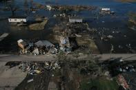 Destroyed homes are surrounded by flood waters in aftermath of Hurricane Delta in Cameron, Louisiana