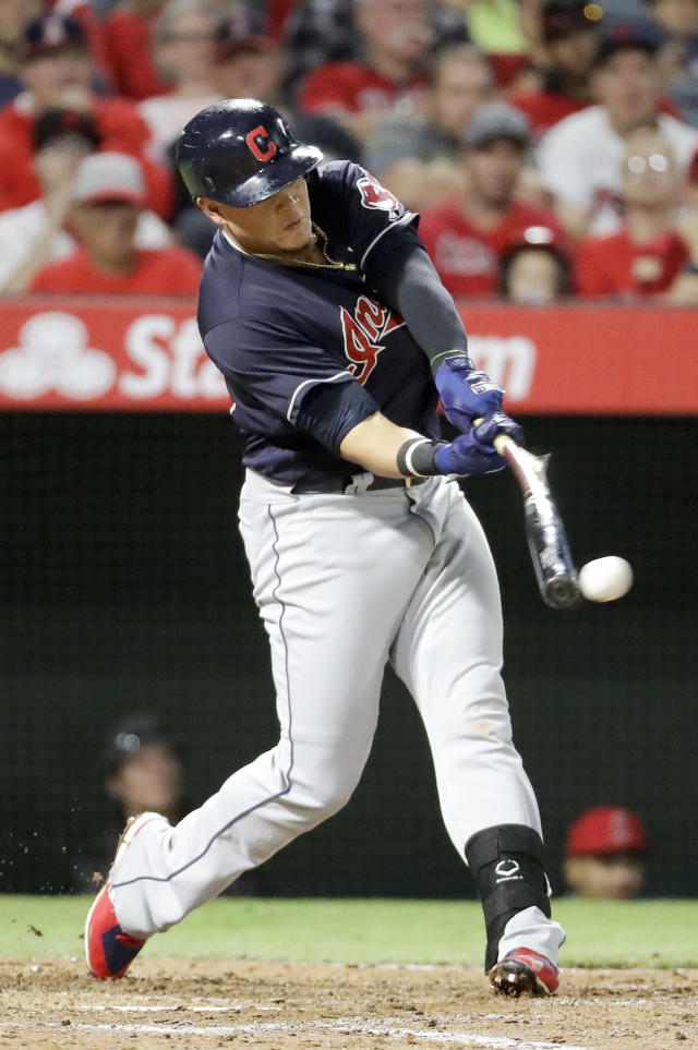 Cleveland Indians' Giovanny Urshela hits an RBI single against the Los Angeles Angels during the fourth inning of a baseball game in Anaheim, Calif., Wednesday, Sept. 20, 2017. (AP Photo/Chris Carlson)