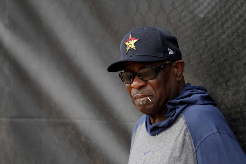 Houston Astros manager Dusty Baker leans against at fence during spring training baseball practice Thursday, Feb. 13, 2020, in West Palm Beach, Fla. (AP Photo/Jeff Roberson)