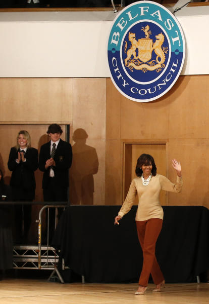 US First Lady Michelle Obama waves after her husband US President Barack Obama delivered a keynote address ahead of the G-8 summit at Waterfront Hall in Belfast, Northern Ireland on Monday, June 17, 2013. (AP Photo/Peter Morrison)
