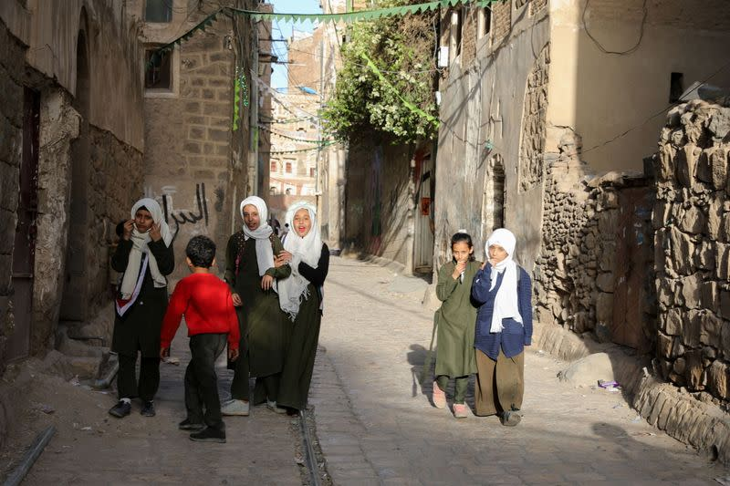 Girls walk in an alley in the old quarter of Sanaa