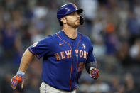 New York Mets' Pete Alonso watches his two-run home run during the fourth inning of the second baseball game of a doubleheader against the New York Yankees on Sunday, July 4, 2021, in New York. (AP Photo/Adam Hunger)