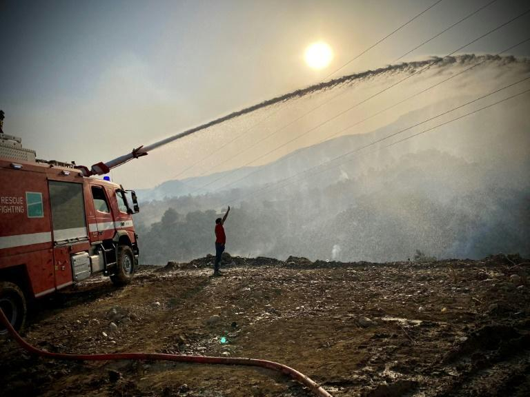 Winds whipped up a flash fire that subsumed the grounds of an Aegean coast power plant in Turkey storing thousands of tonnes of coal.