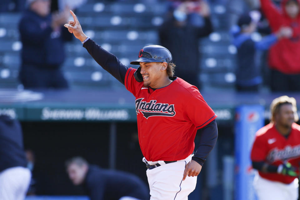 Cleveland Indians' Josh Naylor celebrates scoring the game winning run on a single by Amed Rosario off Chicago Cubs pitcher Keegan Thompson during the tenth inning of a baseball game, Wednesday, May 12, 2021, in Cleveland. The Indians defeated the Cubs 2-1. (AP Photo/Ron Schwane)