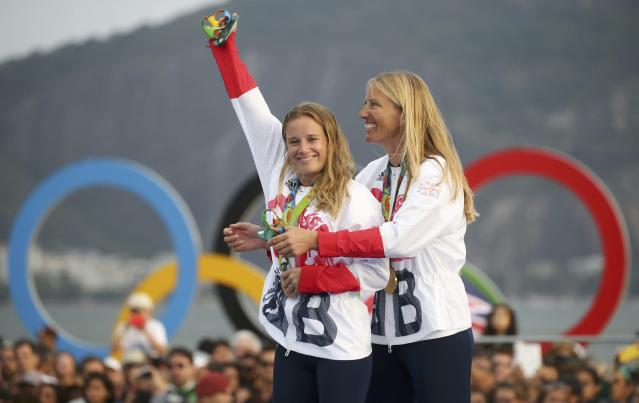 2016 Rio Olympics - Sailing - Victory Ceremony - Women's Two Person Dinghy - 470 - Victory Ceremony - Marina de Gloria - Rio de Janeiro, Brazil - 18/08/2016. Gold medalists Hannah Mills (GBR) of Britain and Saskia Clark (GBR) of Britain pose with their medals. REUTERS/Benoit Tessier FOR EDITORIAL USE ONLY. NOT FOR SALE FOR MARKETING OR ADVERTISING CAMPAIGNS.