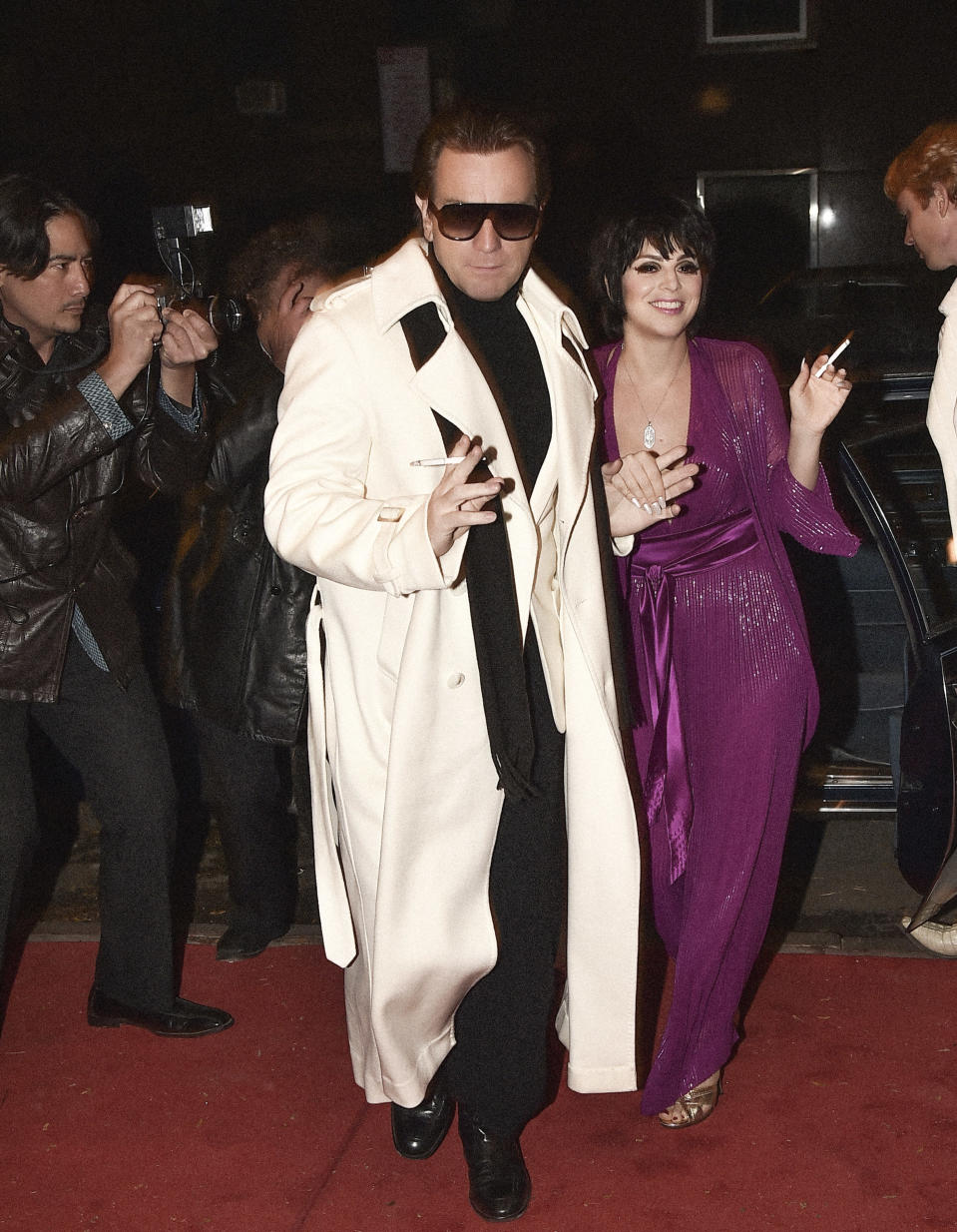 """This image released by Netflix shows Krysta Rodriguez, right, and Ewan McGregor in a scene from """"Halston,"""" premiering Friday. (Netflix via AP)"""