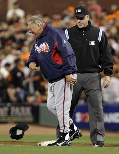 FILE - In this Oct. 8, 2010 file photo, Atlanta Braves manager Bobby Cox throws his hat in front of umpire Paul Emmel just before he was ejected for arguing that Alex Gonzalez was safe in the second inning of Game 2 of the National League Division Series baseball game against the San Francisco Giants in San Francisco. With baseball's expanded replay rule this season, those colorful, saliva-trading tirades Bobby Cox and Lou Piniella made famous could very well be replaced by far more civilized behavior. (AP Photo/Ben Margot, File)