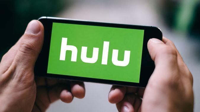 COLOGNE, GERMANY - FEBRUARY 27, 2018: Close up of Hulu logo displayed on Apple iPhone.