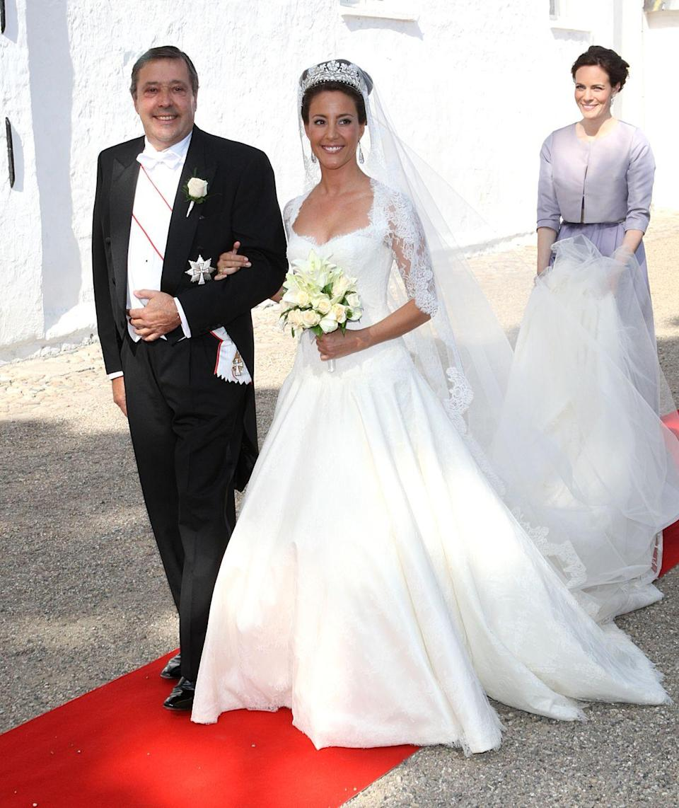 <p>Marie Cavallier's dress featured a lace bodice, three-quarter length sleeves, and a flowing skirt with lace overlay.</p>