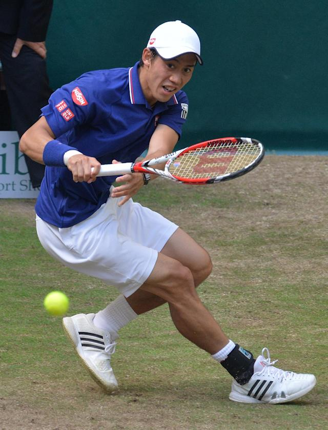 Kei Nishikori from Japan eyes the ball during his match against Swiss Roger Federer at the ATP Gerry Weber Open tennis tournament in Halle, western Germany on June 14, 2014 (AFP Photo/Carmen Jaspersen)