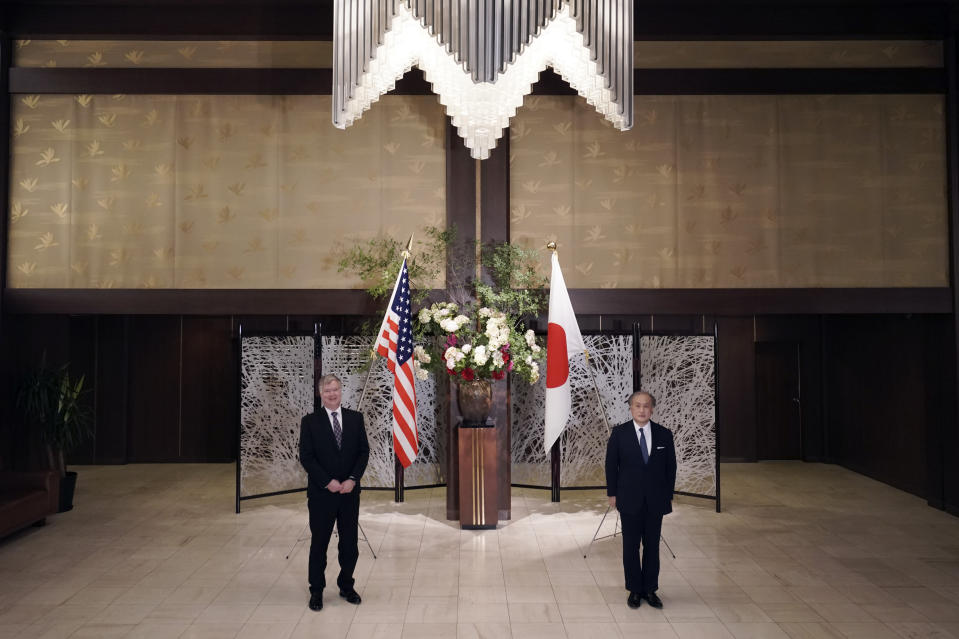U.S. Special Representative for North Korea Stephen Biegun, left, and Japanese Vice Foreign Minister Takeo Akiba, right, pose for a photo session prior to their bilateral meeting at Iikura Guest House Thursday, July 9, 2020, in Tokyo. (AP Photo/Eugene Hoshiko, Pool)