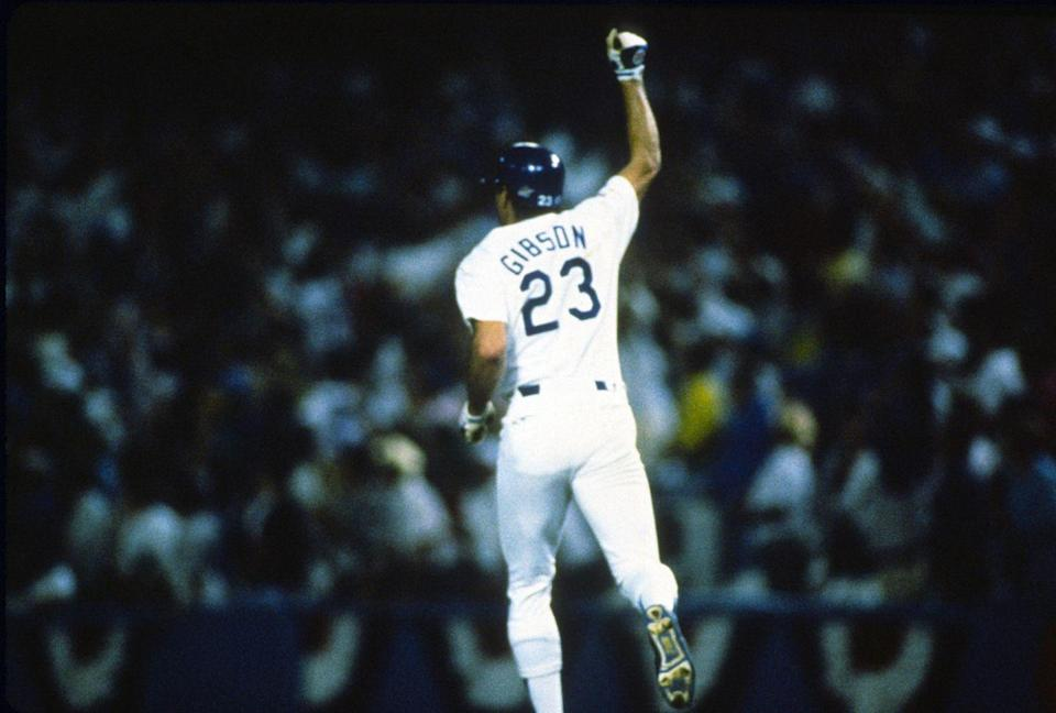 """<p><strong>October 15, 1988</strong>: Bobby Thompson, Bill Mazeroski, and Kirk Gibson. That's the short list for most dramatic postseason homers ever, and Gibson's pinch-hit poke—with a bad wheel, against an unhittable Dennis Eckersley, with the Dodgers a run down in the ninth to the heavily favored A's in Game 1 of the World Series—may be the most electric ever.<br><br>Before Gibson could have the signature moment of his notable career, he had to battle from two strikes down to a full count, and his dribbler up the first-base line stayed just foul. Finally, though, Eckersley, who had thrown nothing but fastballs to the ailing Gibson, made the biggest mistake of his career.<br><br>""""I was tired of throwing fastballs, so I thought to myself, if I give him something off-speed, maybe he'll pull it off,"""" Eck told ESPN in 2008. """"It was really stupid, because something off-speed is probably the only thing he can get to at this point.""""<br><br>Gibson was waiting on the backdoor slider and rocked it 400 feet, over the right-field fence. The Dodgers won Game 1 and took the Series in five games. Eckersley and the A's would win the earthquake-interrupted '89 Series, against the Giants. But this moment belonged to Los Angeles.<br><br>""""When Gibson hit that home run, I jumped up onto my mom's coffee table and broke it,"""" remembers Millar. """"Growing up in L.A. as a Dodger fan, this was a tremendous moment.""""<br> </p>"""