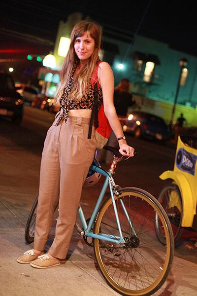 """Vintage pedal-er - This girl looks like she just stepped out of a summer-y, more '90s-tinged version of """"Annie Hall."""" Bonus points for the helmet we spy on the handlebars: safety first, people!"""