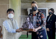 Danish Prime Minister Mette Frederiksen receives a bust of Mahatma Gandhi as a memento at Rajghat, the memorial dedicated to the Indian independence leader, in New Delhi, India, Saturday, Oct. 9, 2021. (AP Photo)