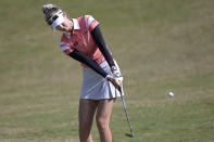 Nelly Korda chips onto the seventh green during the final round of the Tournament of Champions LPGA golf tournament, Sunday, Jan. 24, 2021, in Lake Buena Vista, Fla. (AP Photo/Phelan M. Ebenhack)