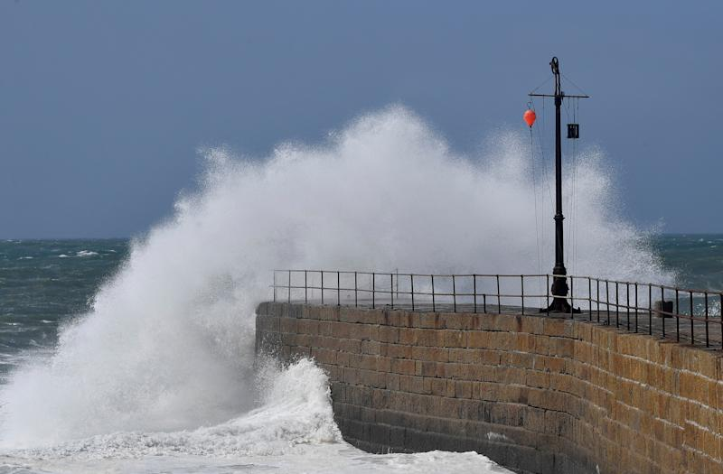 Large waves hit the harbour at Porthleven, Britain, August 10, 2019. REUTERS/Toby Melville.