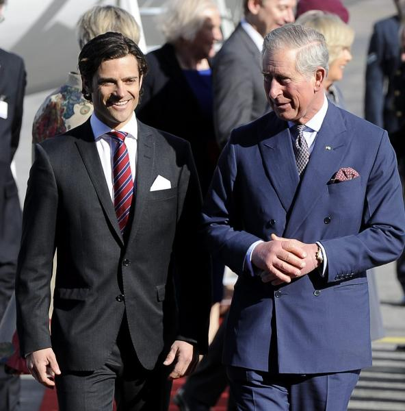 Prince Carl Philip of Sweden, left, welcoming Britain´s Prince Charles and Camilla, Duchess of Cornwall, at the Arlanda Airport in Stockholm, Sweden, March 22, 1012. The British Royal Couple are in Sweden for an official visit. (AP Photo/Scanpix, Anders Wiklund) SWEDEN OUT