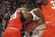 Syracuse guard Frank Howard (23) reaches for the ball held by Michigan State forward Xavier Tillman during the second half of a second-round game in the NCAA men's college basketball tournament Sunday, March 18, 2018, in Detroit. (AP Photo/Carlos Osorio)