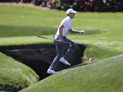 Jordan Spieth runs across the tributary to Rae's Creek to the 13th green during his practice round for the Masters at Augusta National Golf Club on Tuesday, April 6, 2021, in Augusta, Ga. (Curtis Compton/Atlanta Journal-Constitution via AP)