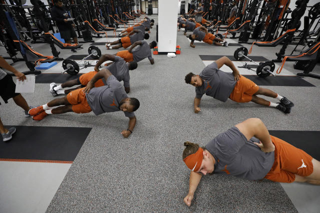 Texas Longhorns football players stretch during their morning workout Wednesday Sept. 4, 2019 in Austin, Tx. ( Photo by Edward A. Ornelas )