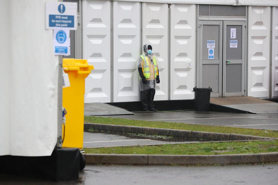 Security staff at the overflow mortuary at Breakspear Crematorium in Ruislip, London (PA)