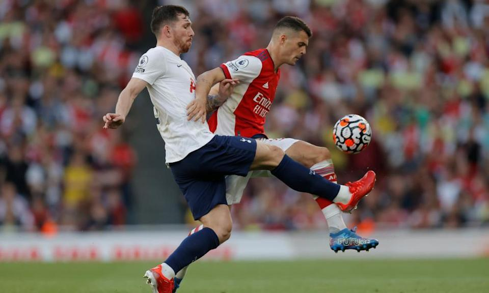 Granit Xhaka battles for the ball with Pierre-Emile Højbjerg.