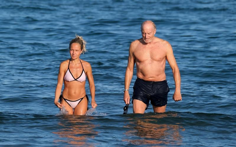 Charles Dance was pictured with an unnamed woman at the beach in Venice - CIAO