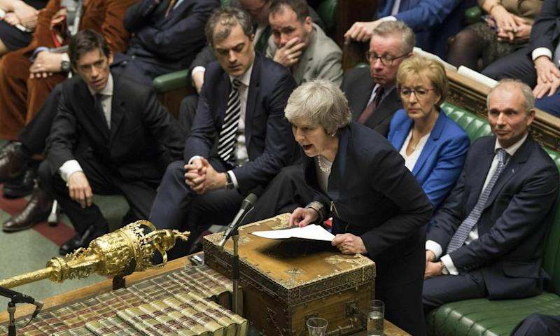 British Prime Minister Theresa May speaks in the House of Commons in London after losing a vote on her Brexit plan
