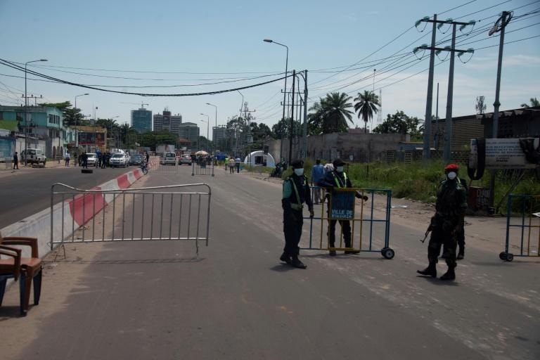 Access to Gombe, which houses the country's main institutions, banks and foreign embassies as well as upscale homes, was barricaded off to everyone except local residents and key workers (AFP Photo/Bienvenu-Marie Bakumanya)