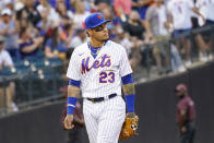 New York Mets' Javier Baez looks up into the stands as he enters the field for the first time as a Met in the first inning of the baseball game against the Cincinnati Reds, Saturday, July 31, 2021, in New York. (AP Photo/Mary Altaffer)