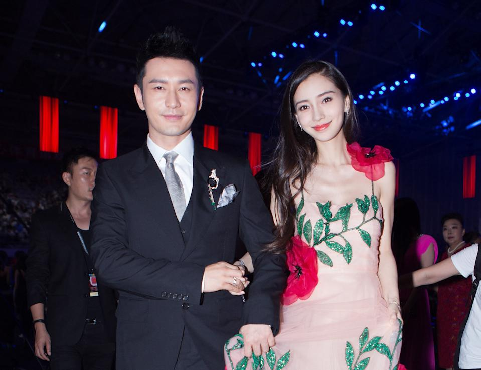 BEIJING, CHINA - SEPTEMBER 09:  Actor Huang Xiaoming and wife Angelababy pose at red carpet of the 2016 Bazaar Star Charity Night on September 9, 2016 in Beijing, China.  (Photo by Visual China Group via Getty Images/Visual China Group via Getty Images)