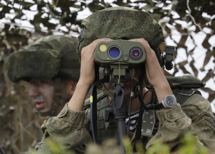 """A Russian officer watches during Russian military maneuvers Vostok 2018 on the training ground """"Klerk,"""" about 50 kilometers (31 miles) south of Vladivostok, Russian Far East port, Russia, Saturday, Sept. 15, 2018. The weeklong Vostok 2018 maneuvers are the largest war games Russia ever had. (AP Photo/Sergei Grits)"""
