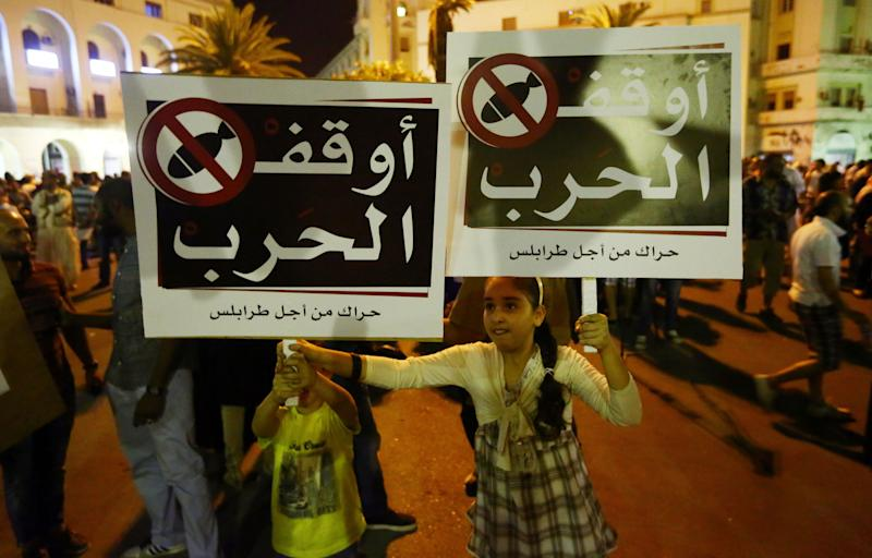 Libyans demand an end to the conflict in the country during a protest in Algeria Square July 26, 2014 in Tripoli, Libya
