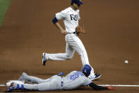 Toronto Blue Jays' Cavan Biggio (8) slides safely into first base with a single as Tampa Bay Rays starting pitcher Charlie Morton can't field the throw from first baseman Yandy Diaz during the fourth inning of a baseball game Friday, July 24, 2020, in St. Petersburg, Fla. (AP Photo/Chris O'Meara)