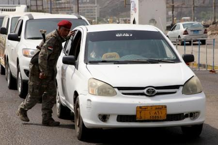 Southern separatist fighter mans a checkpoint in Aden
