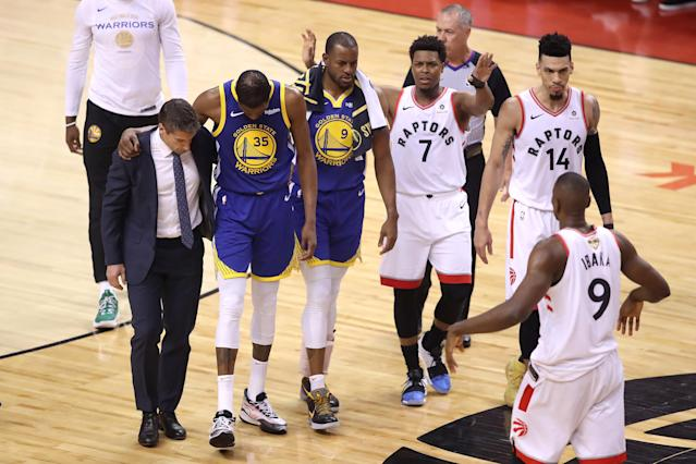 Kyle Lowry of the Toronto Raptors reacts as Kevin Durant of the Golden State Warriors is carried off the court in the first half during Game 5 of the 2019 NBA Finals at Scotiabank Arena on June 10, 2019 in Toronto, Canada. (Claus Andersen/Getty Images)