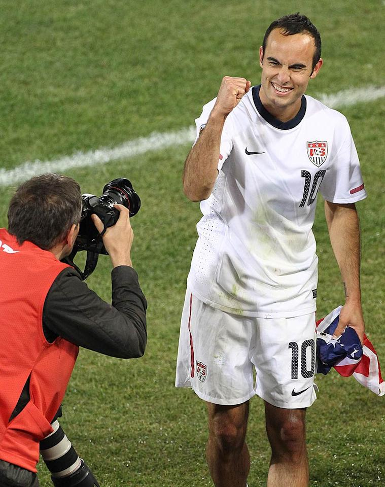 """Fist pump! Clutching an American flag, Landon Donovan celebrated Team USA's 1-0 World Cup victory over Algeria Wednesday. Thanks to their last minute goal, the USA qualified for the round of 16, where they'll face Ghana this Saturday. Juan Soliz/<a href=""""http://www.pacificcoastnews.com/"""" target=""""new"""">PacificCoastNews.com</a> - June 23, 2010"""