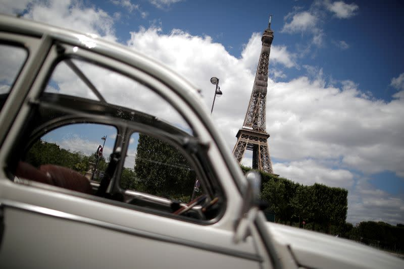 FILE PHOTO: Paris iconic 2CV tours feel brunt of COVID-19 impact on tourism