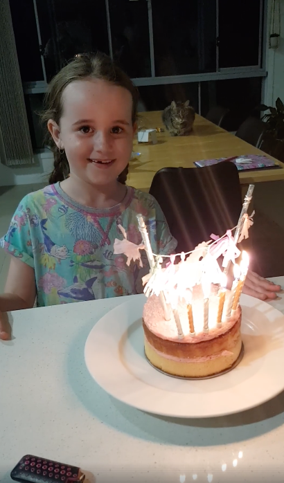 It was all smiles before Luella blew out all candles... and saw her cake topper go up in flames. Photo: Facebook/bec.skinner.9