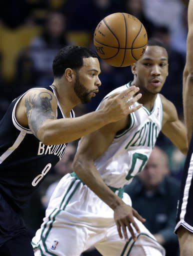 Brooklyn Nets point guard Deron Williams (8) controls the ball as Boston Celtics guard Avery Bradley (0) defends during the first quarter of an NBA basketball game in Boston, Wednesday, April 10, 2013. (AP Photo/Elise Amendola)
