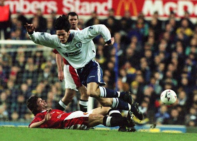 Manchester United's Roy Keane (lying left) tackles Tottenham Hotspur's Rory Allen during today's (Sunday) FA Carling Premiership match at White Hart Lane. Photo by David Cheskin/PA.