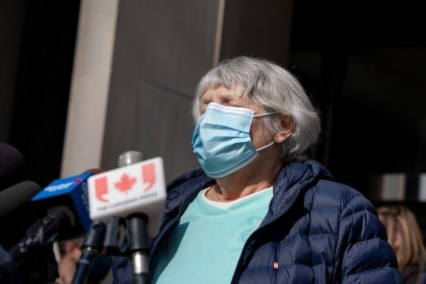 Toronto van attack victim Cathy Riddell speaks with the media outside the Superior Court of Justice on March 3, 2021. She says she has no memory of the incident itself.
